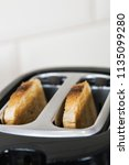 two slices of fried toast... | Shutterstock . vector #1135099280