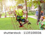 little boy in safety equipment... | Shutterstock . vector #1135100036