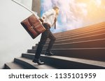 young businessman upstair on... | Shutterstock . vector #1135101959