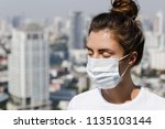 woman wearing face mask because ... | Shutterstock . vector #1135103144