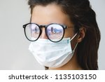 healthcare   woman wearing face ... | Shutterstock . vector #1135103150