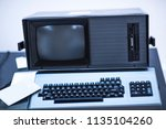 old and obsolete computer on... | Shutterstock . vector #1135104260