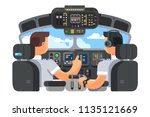 pilots in cockpit plane with... | Shutterstock .eps vector #1135121669