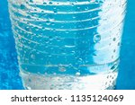 plastic glass or cup of cold... | Shutterstock . vector #1135124069