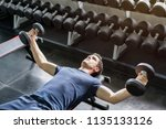 handsome weightlifter lifting... | Shutterstock . vector #1135133126