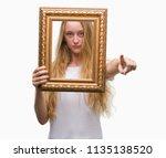 blonde teenager woman holding... | Shutterstock . vector #1135138520