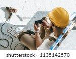 overhead view of builder in... | Shutterstock . vector #1135142570