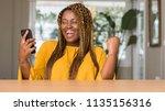 african american woman using...   Shutterstock . vector #1135156316