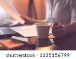 businesswoman sitting at her... | Shutterstock . vector #1135156799