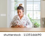 young woman at home with hand... | Shutterstock . vector #1135166690