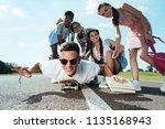 happy teenage multiethnic...   Shutterstock . vector #1135168943