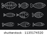 set of vector stylized fishes.... | Shutterstock .eps vector #1135174520