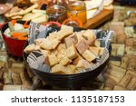 bread pieces in a basket | Shutterstock . vector #1135187153