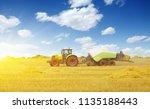 tractor working on farm field | Shutterstock . vector #1135188443