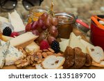 healthy cheese and fruits in a... | Shutterstock . vector #1135189700