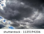 thunderclouds in the sky as a... | Shutterstock . vector #1135194206