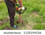 worker drills the ground at the ... | Shutterstock . vector #1135194236