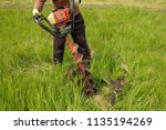 worker drills the ground at the ... | Shutterstock . vector #1135194269