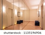 corridor with wardrobes and... | Shutterstock . vector #1135196906