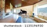 modern living room with wooden... | Shutterstock . vector #1135196930