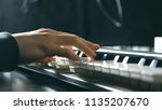 close up fingers of pianist at... | Shutterstock . vector #1135207670
