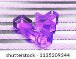purple upload icon on the gray... | Shutterstock . vector #1135209344