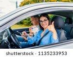 driving school. beautiful young ... | Shutterstock . vector #1135233953