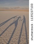 people shadow salar de atacama  ... | Shutterstock . vector #1135237103