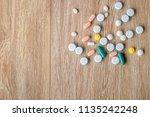 pill spilling out of a bottle  ... | Shutterstock . vector #1135242248