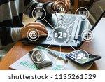 businessman presses button b2b... | Shutterstock . vector #1135261529