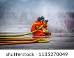 Fireman Using Water And...