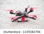 racing drone stands on ground... | Shutterstock . vector #1135282706
