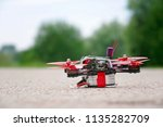 racing drone stands on ground... | Shutterstock . vector #1135282709