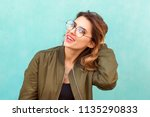 fashion girl in round glasses... | Shutterstock . vector #1135290833