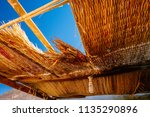 the hole in the straw roof and...   Shutterstock . vector #1135290896