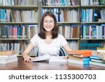 young happy student reading... | Shutterstock . vector #1135300703