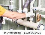 a worker or an engineer checks... | Shutterstock . vector #1135301429