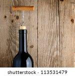 bottle of wine with corkscrew... | Shutterstock . vector #113531479