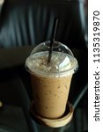 cup of iced coffee closeup | Shutterstock . vector #1135319870