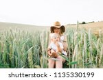 a young mother and her little... | Shutterstock . vector #1135330199