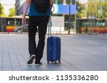 man with a suitcase is walking... | Shutterstock . vector #1135336280