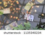 wishing well with cash   Shutterstock . vector #1135340234