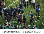france's footballers celebrate... | Shutterstock . vector #1135344170