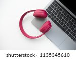 flay lay of pink wireless... | Shutterstock . vector #1135345610