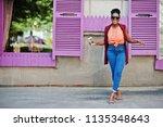 african american girl in... | Shutterstock . vector #1135348643