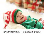 Cute Baby In Christmas Costume...