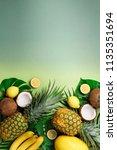 exotic pineapples  coconuts ... | Shutterstock . vector #1135351694