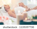 relaxed young woman lying on...   Shutterstock . vector #1135357730