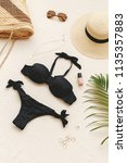 black bikini swimsuit  straw... | Shutterstock . vector #1135357883