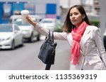 business woman is calling the... | Shutterstock . vector #1135369319